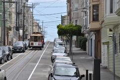 Steep street with trolley in Russian Hill, San Francisco. August 2014 - View of a very steep street with cars and trolley in Russian Hill, San Francisco ( Royalty Free Stock Photography