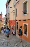 Steep streets of Rovinj old town with tourists and shops  Croatia. Royalty Free Stock Photo
