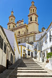 Steep village street leading to the Church (Parish of Our Lady of the Incarnation), Olvera, Cadiz Province, Andalusia, Spain, West Stock Photo
