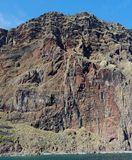 Steep weathered cliff near Cabo Girao on Madeira island. Seen from sea Stock Images