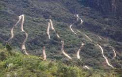 Steep winding road leading up to Machu Picchu from Royalty Free Stock Images