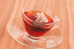 Steeping tea bag in a glass cup close up Royalty Free Stock Photo