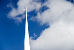 Steeple. A white church steeple with cross on top and blue sky royalty free stock photography