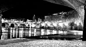 The steeple and amedeo d,aosta the bridge. The bridge in night vision in b / n from the shore of the tiber after a violent rain that has made much of the argines royalty free stock photos