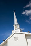 Steeple on Angle. Church steeple on angled view with lights Stock Photo