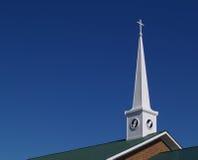 Steeple della chiesa con le mani di preghiera Immagini Stock