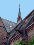 Steeple, flying buttresses, gargoyles Middle Church, Perth. Architectural details from the old Middle Church in Tay Street, Perth, Scotland, now converted to royalty free stock images