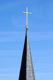 Steeple with golden cross Stock Photography