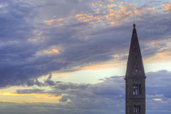 Steeple in the Heavens Above Florence, Italy. Steeple of the Basilica of Santa Maria Novella in Florence (Firenze), Italy, reaches heaven-ward in the Tuscan Royalty Free Stock Photo