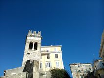 Steeple in the old town of Corfu. Steeple in Corfu. in Evgeniou Voulgareos street Royalty Free Stock Photo