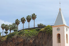 Steeple of the parish church in Camara de Lobos and mound of roc Royalty Free Stock Images