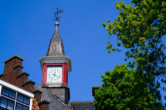 Steeple with a red clock Stock Image