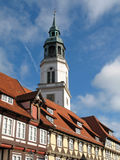 Steeple of town church. And half-timbered houses in Celle, Lower Saxony, Germany royalty free stock image