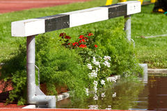 Steeplechase. Moat in steeplechase in track and field Stock Photography