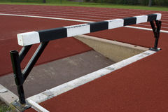 Steeplechase barrier with water jump Stock Image
