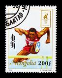 Steeplechase, Summer Olympics 1996, Atlantaserie, circa 1996. MOSCOW, RUSSIA - NOVEMBER 25, 2017: A stamp printed in Mongolia shows Steeplechase, Summer Olympics Royalty Free Stock Photography