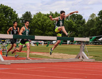 Steeplechase. Three steeplechase participants compete in this event at this track meet in Redding, California April 26, 2014 Stock Photos
