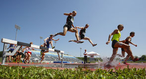 Steeplechase Track Men Water Jump. Competitors in the men's 3000-meter steeplechase at the Canadian Track & Field Championships June 28, 2014 in Moncton, Canada Stock Image