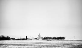 Steepled kyrka i avståndet Royaltyfria Bilder