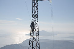 Steeplejack. Climb on the metal support Stock Image
