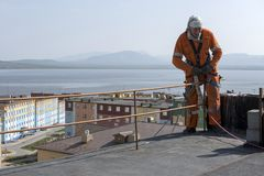 Steeplejack. At work on the wall of the building Stock Images