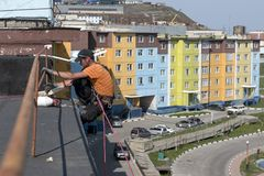 Steeplejack at work. On the wall of the building Stock Image