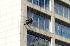 Steeplejack works. Cleaning building facade Royalty Free Stock Images