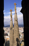 Steeples through the archway. A close up of two of the steeples of Antoni Gaudi's Sagrada Familia in Barcelona Spain as seen through an archway in an ajacent stock photo