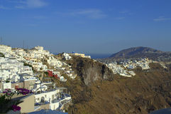 Steep Santorini island coast Stock Images