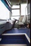 Steering bus of public transportation. Inside view of bus interior for public transportation Stock Photos