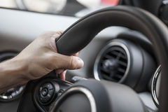 Steering hand Royalty Free Stock Images