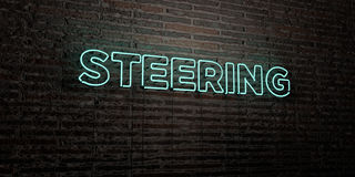 STEERING -Realistic Neon Sign on Brick Wall background - 3D rendered royalty free stock image Royalty Free Stock Photos