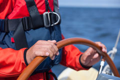 Steering a sailboat Royalty Free Stock Photo
