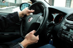 Steering wheel. Young man who's driving, steering wheel Royalty Free Stock Photography