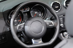 Steering wheel. In a sport car Royalty Free Stock Images