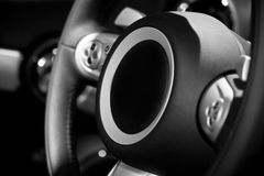 Steering wheel. Balck steering wheel with control buttons and horn stock images