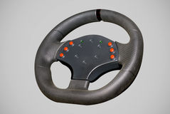 Steering Wheel. High performance racing steering wheel on a light gray background royalty free stock images