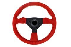 Steering Wheel. Red suede tri-spoke steering wheel for racing vehicles Stock Photos