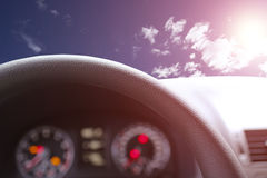 Steering wheel againste sunny day Royalty Free Stock Photos