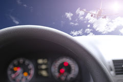 Steering wheel againste sunny day Royalty Free Stock Image
