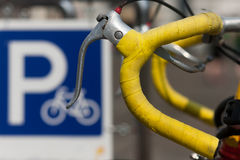 Steering wheel bicycle parking sign on a background Royalty Free Stock Photos