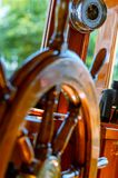 The steering wheel, binoculars and a barometer on a wooden boat stock photography