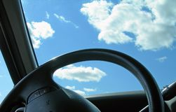 Steering Wheel and Blue Sky. Abstract steering wheel with blue skies above Stock Photos