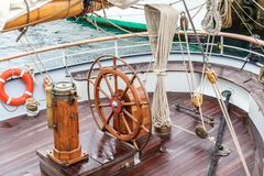 Steering wheel for captain on an old sailboat. Sines. Steering wheel for the captain on an old sailboat Royalty Free Stock Image
