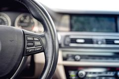 Steering wheel of car, details of buttons and adjustment controls Royalty Free Stock Images