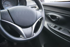 Steering wheel in the car Stock Images