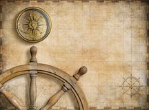 Steering wheel and compass with vintage nautical Royalty Free Stock Images