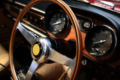 Steering wheel and control panel. For a vintage car stock images