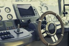 Steering wheel and control panel on a luxury yacht royalty free stock photography