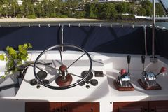 Steering wheel and control panel on yacht. Cruise in tropical Royalty Free Stock Images